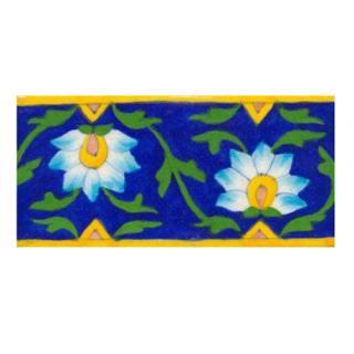 sky blue &white flower with green leaves on blue tile