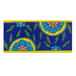 blue tile with turquoise and pink flowers and green leaves