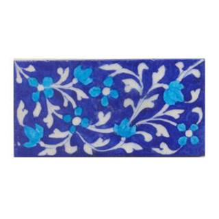 Turquoise flower and blue tile.