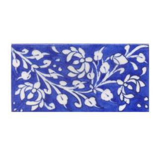 White leaves and flower with blue tile