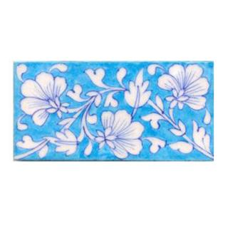 White flower and turqouise tile