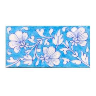 White flower and turqouise tile