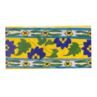 Blue flower and green leaves with yellow tile