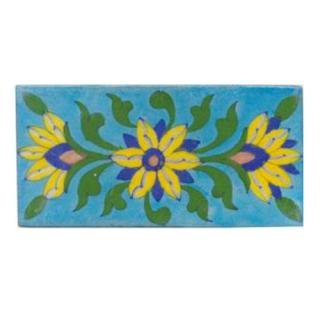 Three yellow,blue,brown and green leaves with turqouise tile