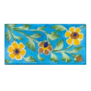 Two yellow and one brown flower and turqouise tile