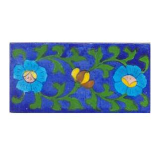 Two turqouise flower and green leaves with blue tile