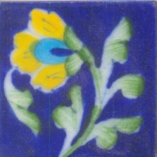 Yellow, turquoise flower with green floral on blue tile
