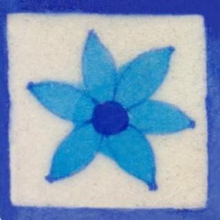 turquoise flower on white tile