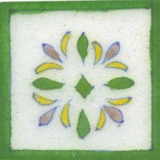 white tile with green border and green pink flower