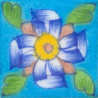 blue and green flower on turquoise tile