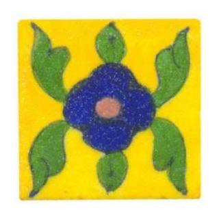 Green leaves with blue flower on yellow tile