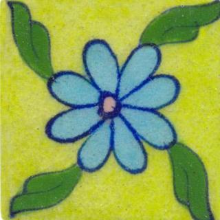 Light blue flower on light green tile