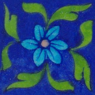 Turquoise flower and green leaves on blue tile