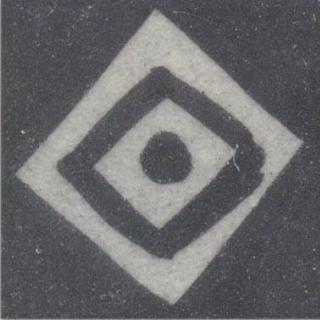 White squire design on black tile