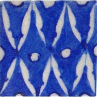 White pattern on blue tile