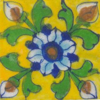 Blue, white , green flower on yellow tile