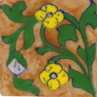 brown tile with green leaves and yellow flower