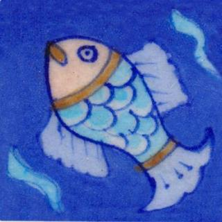 Turquoise fish on blue tile