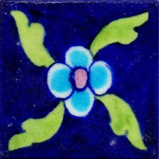 Single Turoise Flower With Green Leaves Design On Blue Tile