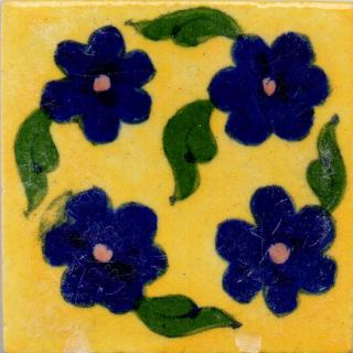 Blue Flowers and Green Leaves On Yellow Base Tile