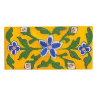 yellow tile painted with blue, pink green design 2x4