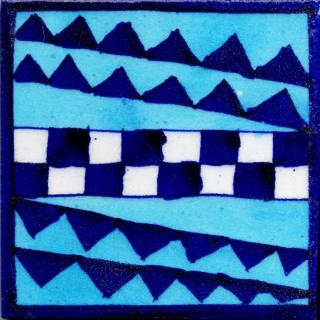 Blue and White Pattren Design On Blue Base Tile